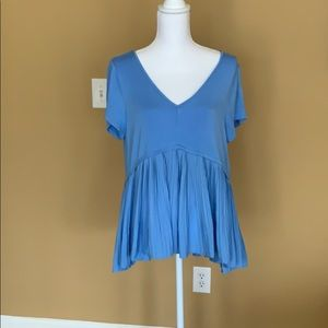 Blue swing tee shirt with pleated bottom